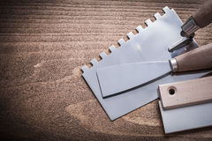 Steel and rubber putty knifes and scrapper.  Royalty Free Stock Image