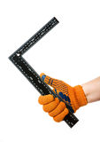 Steel Ruler in hand Royalty Free Stock Image