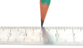Steel ruler and wood pencil Royalty Free Stock Photos