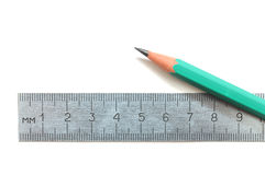 Steel ruler and wood pencil Royalty Free Stock Image