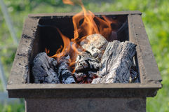 Steel rusty grill with a burning charcoal. Preparation of grill for cooking Royalty Free Stock Photography