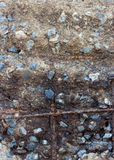 Steel rusty rods in gray concrete wall. Stock Photo