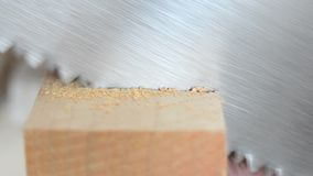 Steel saw, hacksaw cut wooden beam closeup. Carpentry and joinery. stock video footage