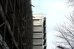 Steel scaffolding used for façade renovation works. In the case of replacement on the façade of insulation or other plaster repairs, scaffolding is often stock photography