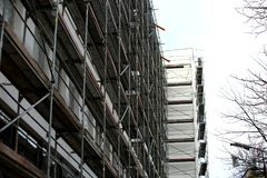 Steel scaffolding used for façade renovation works. In the case of replacement on the façade of insulation or other plaster repairs, scaffolding is often stock photos