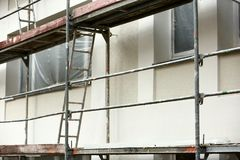 Steel scaffolding used for façade renovation works. In the case of replacement on the façade of insulation or other plaster repairs, scaffolding is often stock images