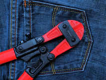 Steel scissors. On Jeans background Stock Photos