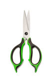 Steel scissors with rubber grips, green and black. Royalty Free Stock Photo