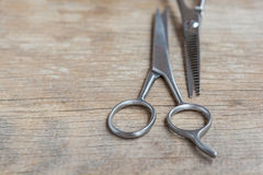 Steel scissors. On wooden background with selective focus Royalty Free Stock Photo