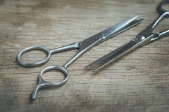 Steel scissors. On wooden background in vintage style royalty free stock image