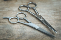 Steel scissors. On wooden background in vintage style Stock Image