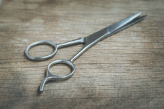 Steel scissors. On wooden background in vintage style royalty free stock photos