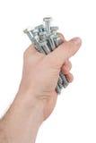 Steel screw in hand Stock Photography