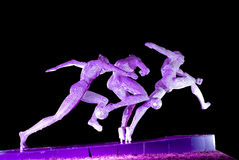 Steel sculpture. Sculpture made by steel lighting by purple light locate at Xinghaiwan Square, Dalian, China Royalty Free Stock Image