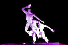 Steel sculpture. Sculpture made by steel lighting by purple light locate at Xinghaiwan Square, Dalian, China Stock Images
