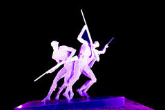 Steel sculpture. Sculpture made by steel lighting by purple light locate at Xinghaiwan Square, Dalian, China Stock Image