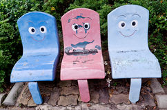Steel seat design friendly but it rust. Steel seat design friendly with smile for people who walk around but it rust Royalty Free Stock Photos