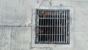 Steel sewer cover on the street Royalty Free Stock Photography