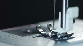 Steel sewing needle in slow motion. Modern sewing machine. Closeup stock video footage