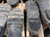 Steel Shank Boot Bottoms, Soles. The worn and dirty treads of steel shank, insulated hip waders. These boots have been stored hung upside down to dry thoroughly Stock Image