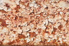 Steel sheet with peeled paint and corrosion stains. Surface of rusty steel sheet with the peeled paint and corrosion stains Royalty Free Stock Photos