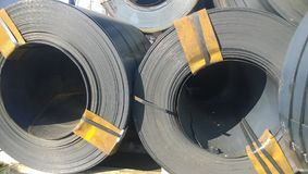 Steel sheets rolled up into rolls. Export Steel. Packing of stee Stock Photo