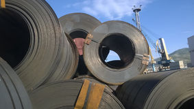 Steel sheets rolled up into rolls. Export Steel. Packing of stee Stock Photography