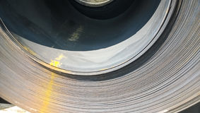 Steel sheets rolled up into rolls. Export Steel. Packing of stee Royalty Free Stock Photo