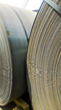 Steel sheets rolled up into rolls. Export Steel. Packing of stee Stock Images