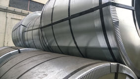 Steel sheets rolled up into rolls. Export Steel. Packing of stee Royalty Free Stock Images