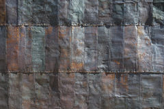 Steel Shingles on Side of Old Mining Building. Pattern of colorful steel shingles intended as pattern, texture or background Royalty Free Stock Images
