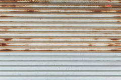 Steel Shutter Door With Rust and Dirt Royalty Free Stock Image