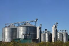 Steel silos for grain storage and processing facilities. Modern elevator.  Stock Photography