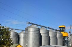 Steel silos for grain storage and processing facilities. Modern elevator.  Royalty Free Stock Photography