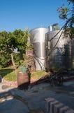 Steel silos for wine in a vinery garden. Steel silos for wine in a greek vinery garden Stock Photos