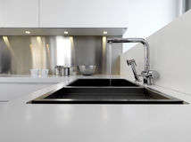 Steel sink and tap in the  modern kitchen Stock Photo