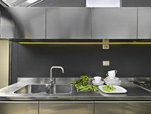 Steel sink and tap in a modern kitchen Stock Photos