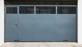Steel sliding gate. And door background Royalty Free Stock Photo