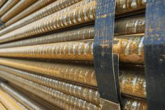 Steel, some round steel bars in the steel bearing outdoor, metal bundled with steel tape, selective focus Royalty Free Stock Photos