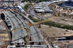 Steel spans of bridge under construction, tower crane Liebherr w Royalty Free Stock Image