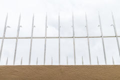 Steel spikes on cement wall. Royalty Free Stock Photos