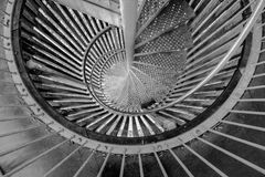 Steel spiral staircase as fire escape. royalty free stock photos