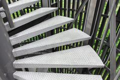 Steel spiral staircase. With steel. battens on natural background stock images