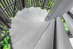 Steel spiral staircase. With steel. battens on natural background stock photography