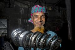 Steel spoon maker worker Bangladesh.