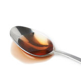 Steel spoon in a puddle of wine vinegar Royalty Free Stock Photo