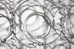 Steel spring. An isolated part of metal spring Royalty Free Stock Photos