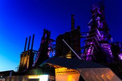 Steel stacks with purple and yellow lighting as entertainment area in downtown Bethlehem Pa. Bethlehem steel stacks turned into public entertainment area in Stock Image