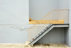 Steel stair with blue wall Royalty Free Stock Image