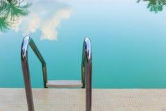 Steel stair of green swimming pool Stock Image
